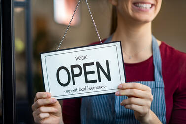 open-sign-in-a-small-business-shop-FYZTKRS