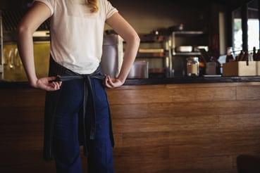 waitress-tying-apron-at-restaurant-3J2SQGN